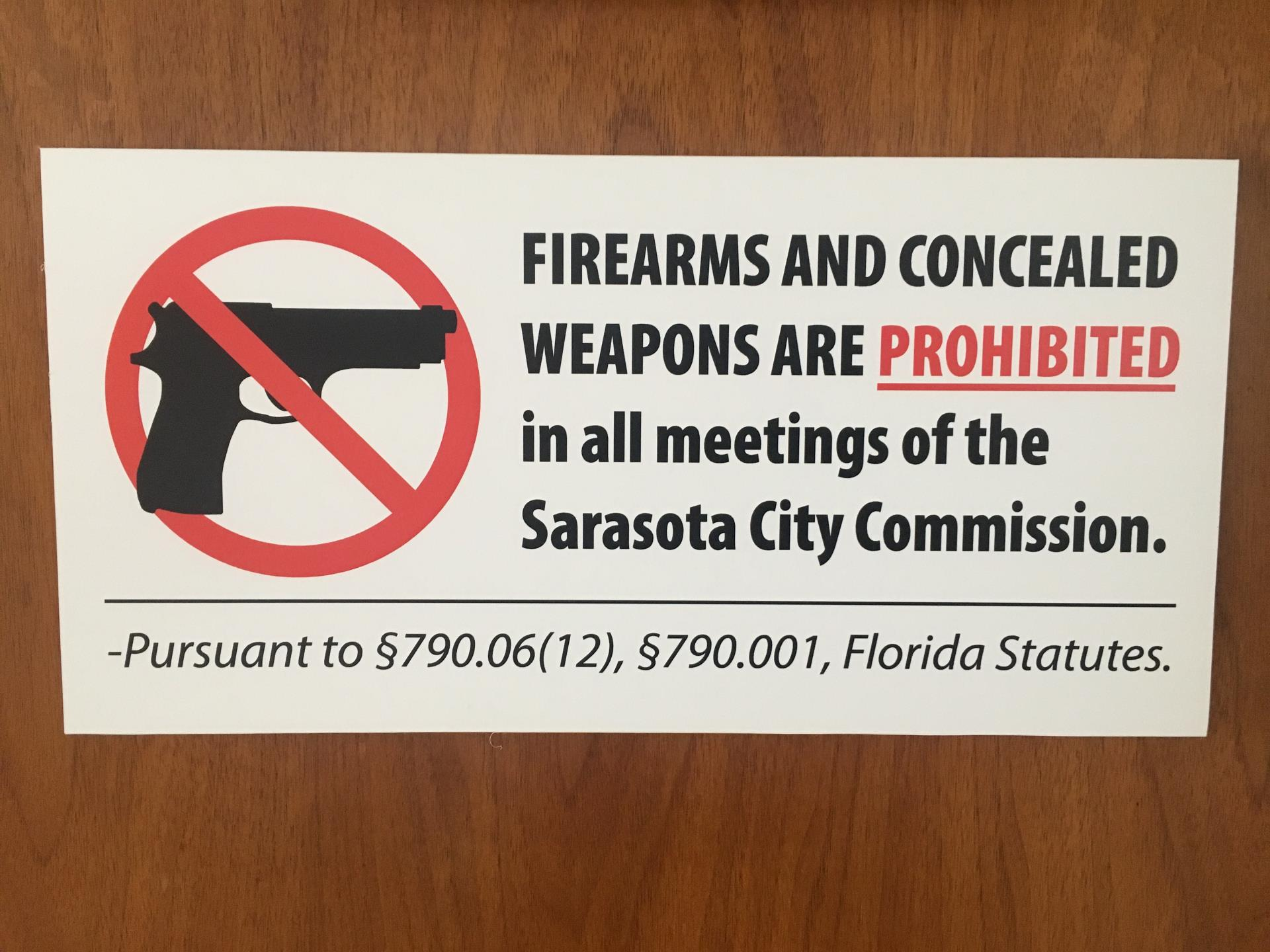 Sign prohibiting firearms at City Commission meetings, per Florida statutes.